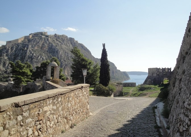 Stone paved road leading to Akronafplia Castle. Nafplia Palace Hotel, the only hotel in Greece that is situated in a historical site, is on the other end of this road offering mafnificient views into the old town of Nafplio, Bourtzi and the Argolid Gulf.
