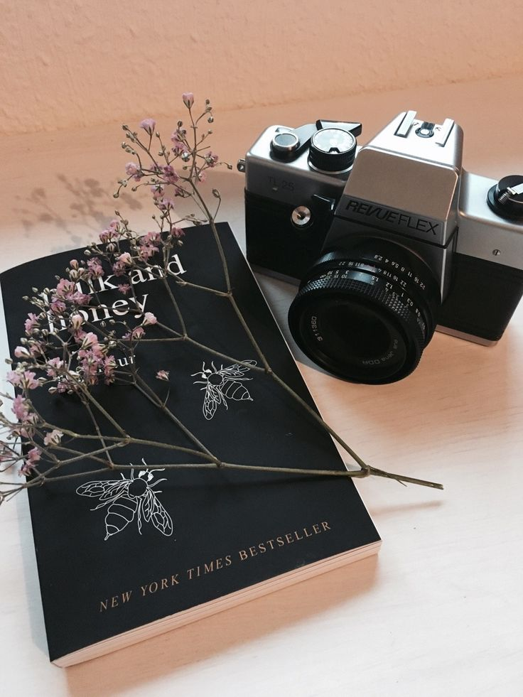 a book with flowers and a camera