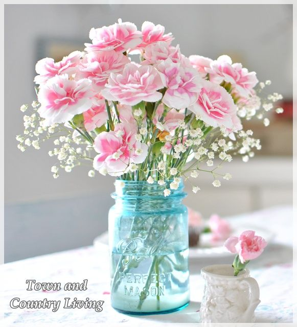 Easy Centerpiece: Pink Carnations in a blue mason jar with baby's breath