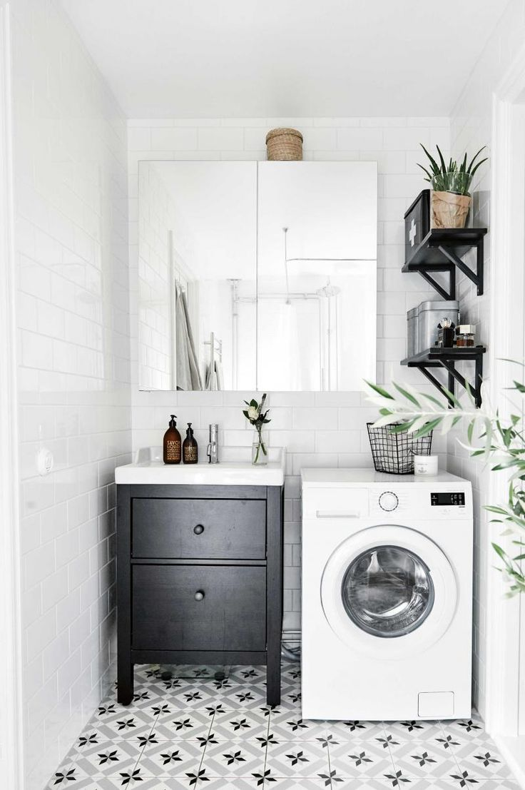 Another gorgeous laundry design.  Who said laundries have to be all white and boring.   Love the tiles and the impact of the greenery.