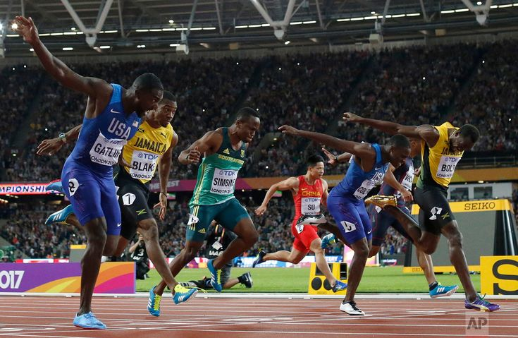 Britain Athletics Worlds United States' Justin Gatlin, left, crosses the line to win gold ahead of silver medal winner United States' Christian Coleman, second right, and bronze medal winner Jamaica's Usain Bolt, right, in the men's 100m final during the World Athletics Championships in London on Aug. 5, 2017. (AP Photo/Matt Dunham)