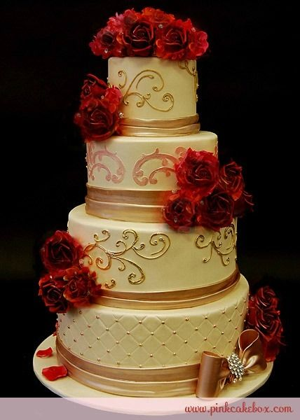 gold/ivory cake with red roses