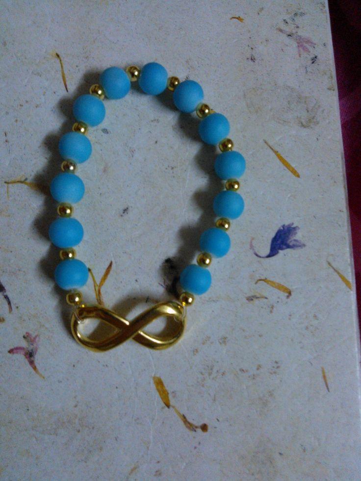 Pulso azul/dorado infinito (varios colores)