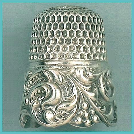Antique thimble with Rococo style scrolling band