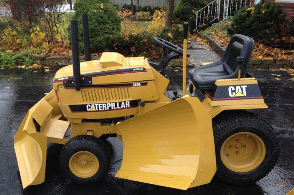 side view of the Cat plows