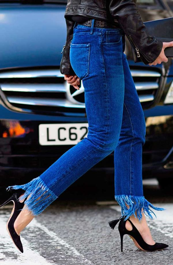 We're all about the latest denim trends and a major look on our radar right now is the fringed hem. Here's how to DIY your own pair of frayed jeansthis summer—you'll earn major street-style cred and save a few bucks that can be better spent on a weekend jaunt.