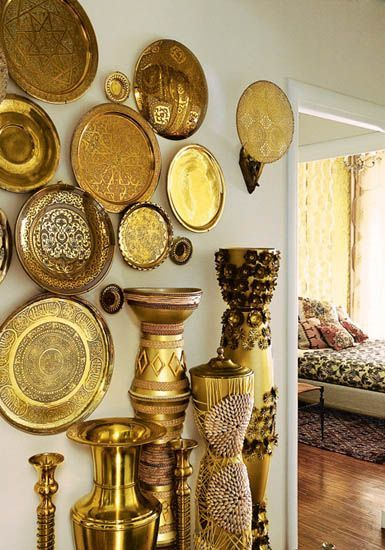 "From a piece on ""Egyptian Interior Style, Modern Room Decorating Ideas"" comes this hallway decorated in brass. Just when I was getting rid of most of mine (I HATE cleaning it!), comes this inspiring photo. Sigh."