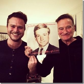 Robin Williams with his son Zachery with a photo of young Robin