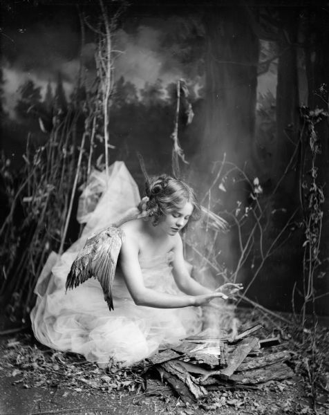 """""""Angel in the Woods.""""  Photograph of Jennie Rooney taken by Ephraim Burt Trimpey of Baraboo, Wisconsin, c. 1930."""