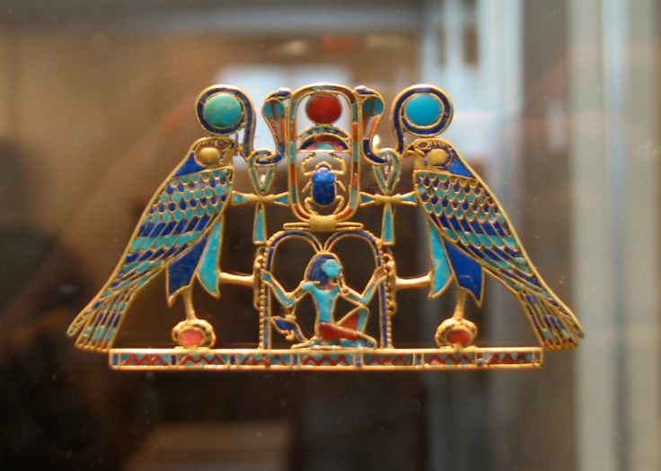 """This cloisonné pectoral is inlaid with 372 carefully cut pieces of semiprecious stones. It is composed around the throne name of King Senwosret II and was found among the jewelry of Princess Sit-hathor-yunet in a special niche of her underground tomb beside the pyramid of Senwosret II at Lahun. Hieroglyphic signs make up the design, and the whole may be read: """"The god of the rising sun grants life and dominion over all that the sun encircles for one million one hundred thousand years..."""""""