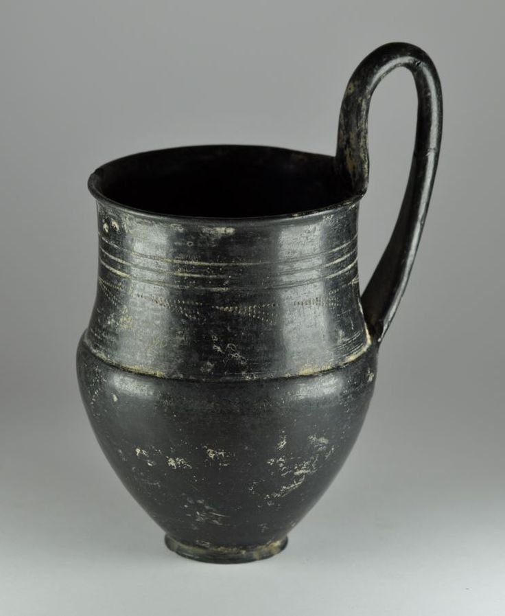 Etruscan bucchero sottile jug, 6th century B.C. Etruscan bucchero sottile jug with handle with decoration, 17.6 cm high. Private collection