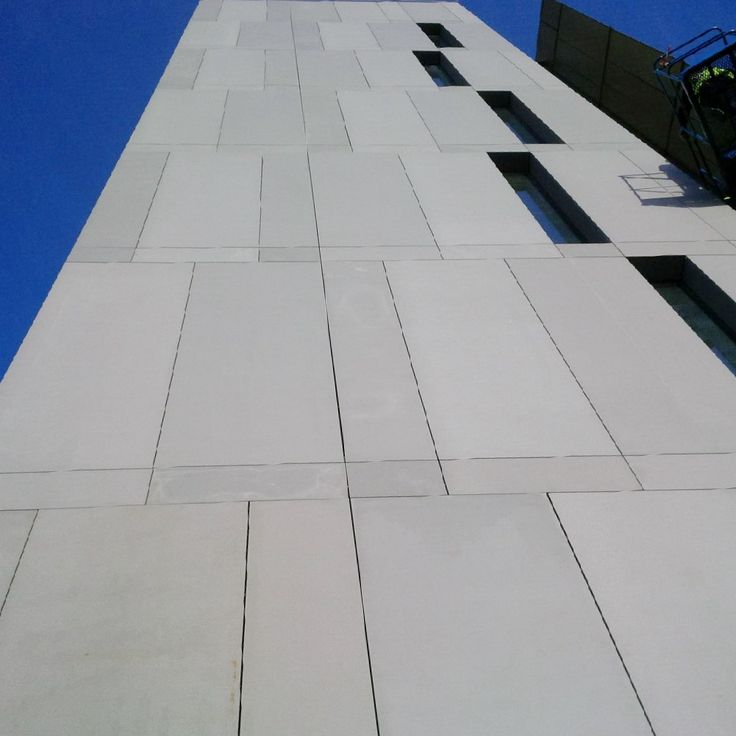 Newcastle Science Park. 1,500 m2 of FibreC. Colour: Silver Grey with matt & ferro finishes to create different surface textures whilst using the same colour. There's also an added feature of a single piece angled window cill with no joint. See more: http://www.purafacades.co.uk/pura-facades-supplies-fibrec-for-the-newcastle-university-science-park/