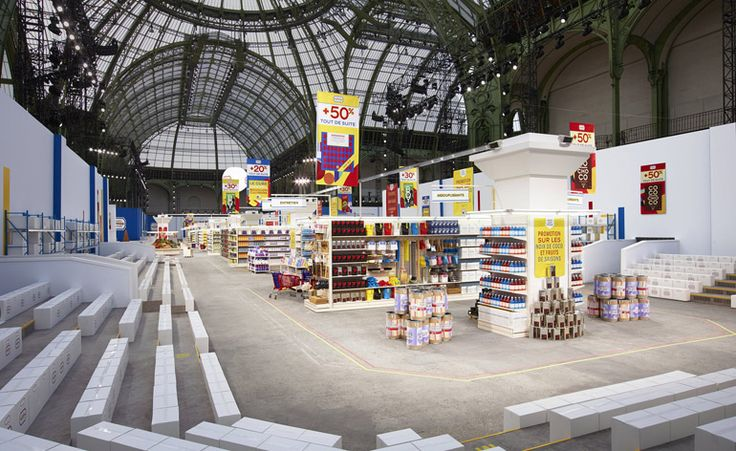 catwalk: CHANEL, supermarket aisles fully stocked with groceries, pinned by Ton van der Veer