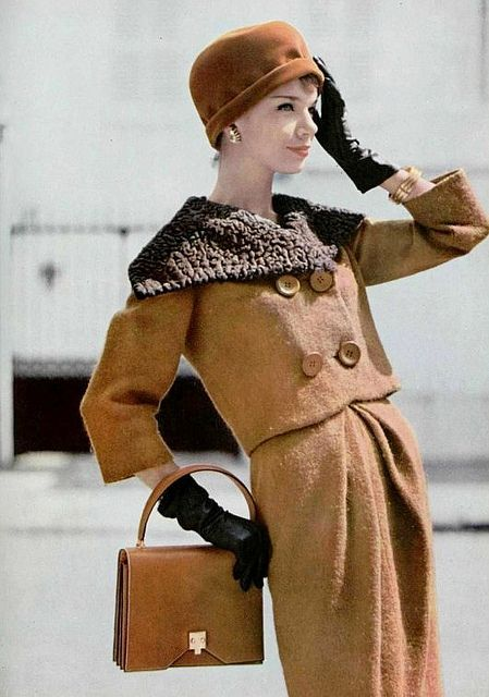 1958 Wool suit with astrakan collar by Pierre Cardin, gloves and handbag by Hermès.