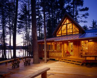 Cabin in the woods overlooking a lake.   Exterior at Dusk - rustic - exterior - portland maine - by Whitten Architects