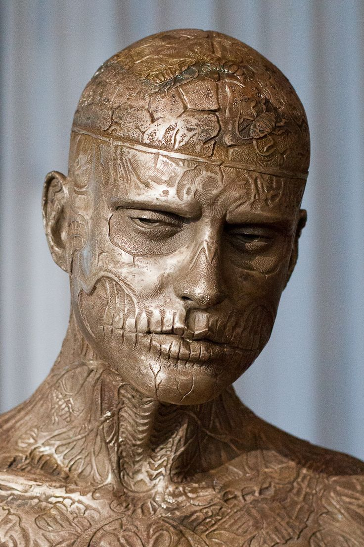 """Zombie Boy' Sculpture by Marc Quinn When I saw this sculpture I was immediately """"wow!"""" I already saw alot of pictures of this zombie boy and I love tattoo's! I think it symbolizes a bit the infinityfeeling of tattoos. It's literally carved in his body."""