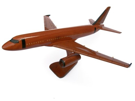 """A beautiful hand carved desktop model of the A320. The model has been carved from solid mahogany. The model comes boxed and is simple to assemble. The wings, tail fins and stand simply slot into pre-drilled holes on the body of the aircraft. No glue required. Size H 9"""", L 19"""", W 17"""". Visit our website at thewoodenmodelcompany.co.uk to view the full range of our models."""