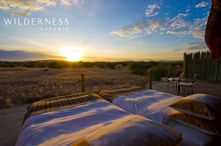 Doro Nawas Camp - a mix of natural stone and canvas walls with wood and glass doors, shaded by a thatch roof. Each unit, is designed to blend into the surrounding scenery, and consists of a bedroom, en-suite bathroom (with outdoor shower) and a veranda for stargazing or sleep outs. #Safari #Africa #Namibia #WildernessSafaris