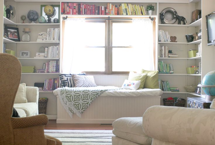 Fascinating Ideas For Home Interior Space Design Using Window Seats With Storage: Gorgeous White Living Room Decoration Using White Wood Window Seats With Storage Including Light Brown Fabric Wing Armchair And Large Mounted Wall White Wood Shelving Unit In Living Room ~ fendhome.com Interior Inspiration
