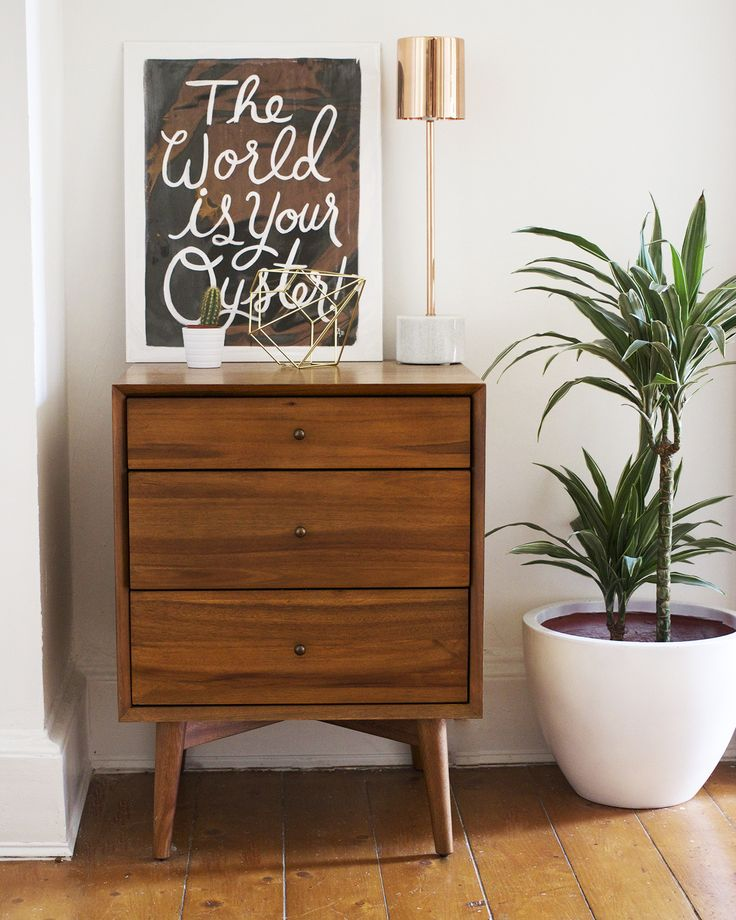 Gorgeous hallway sideboard styling. The mix of wood on the chest of drawers, marble, copper, art and botanicals are a winning mix! via ghostparties
