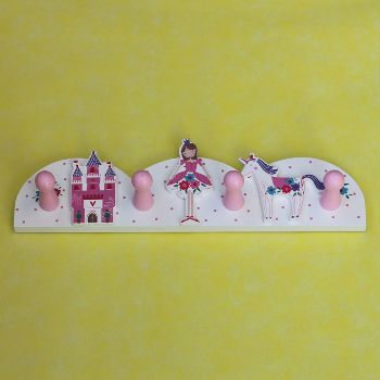 Wooden Princess Peg Rail: A gorgeous fairy tale themed peg rail featuring a castle, ballerina princess and a unicorn on a polka dot and floral base. The rail has two keyhole backings to be hung onto the wall. This peg rail is practical and super delightful looking, making it a perfect addition to a nursery, hallway or bedroom.