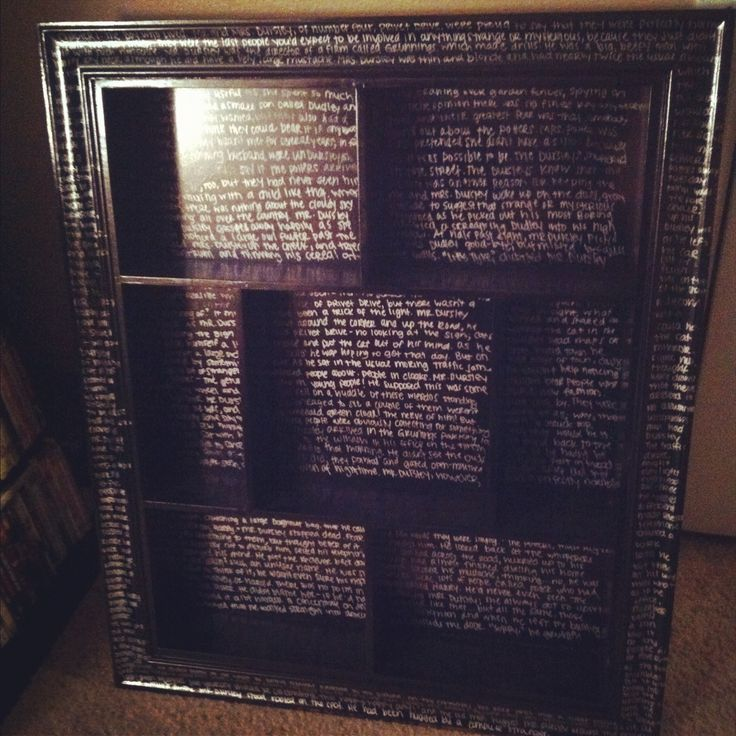 Bookshelf with most of of Chapter One of Harry Potter and the Sorcerer's Stone handwritten on it. Neat idea, but I think I would have just done excerpts on the molding/frame.