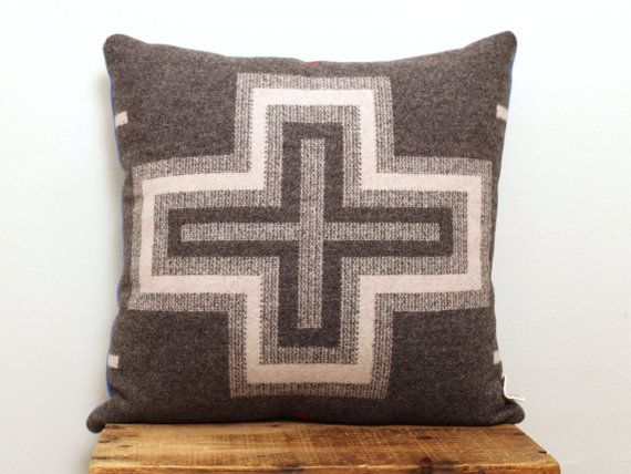 This pillow is hand sewn and made with a limited edition Pendleton Woolen Mill patterned wool. The front is a beautiful deep grey with a cream