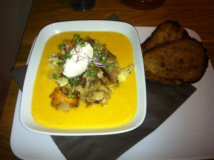 Carrot & Ginger soup, topped with bacon, mushrooms, beet sprouts & sour cream.