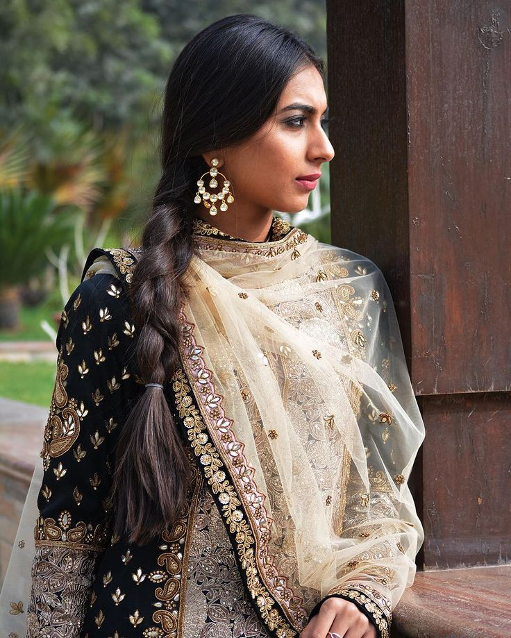 Delicate hand embroideries like zardoz, gotta pati and dori work have been artistically combined together on rich Banarasi silk to create an ensemble that's fit to be treasured through posterity.