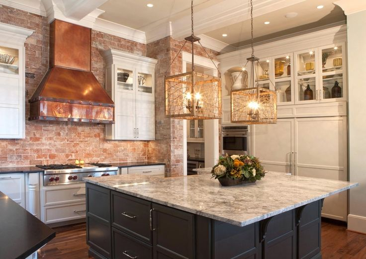 custom kitchen with brick walls copper vent hood and large island - Copper Range Hoods