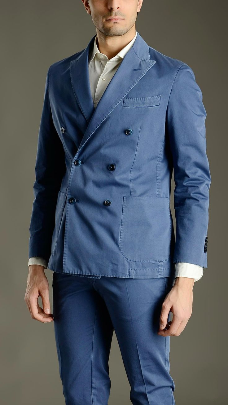 Blue double breasted suit composed by: two button delavè cotton deconstructed jacket characterized by four button fastening cuffs, two patch pockets and a chest pocket at front