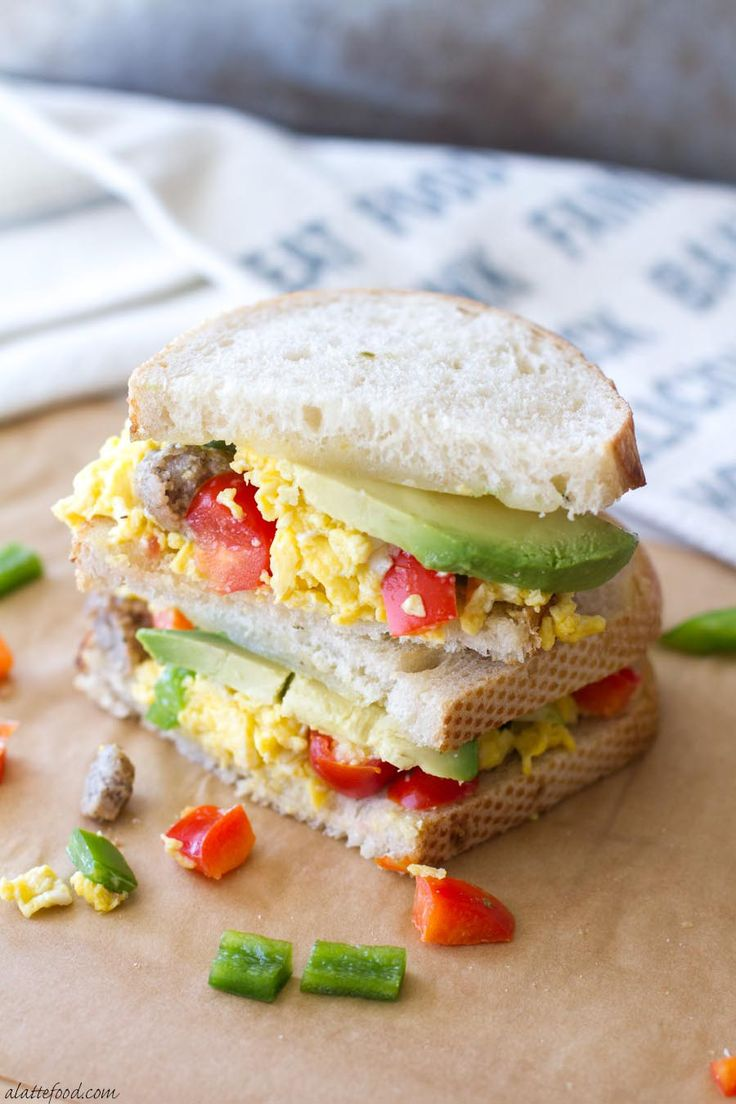 This hearty breakfast sandwich is made with San Luis Sourdough® Bread, scrambled eggs, bell peppers, pepper jack cheese, sausage, and avocado! It's an easy breakfast recipe that will stick with you all morning! [sponsored]