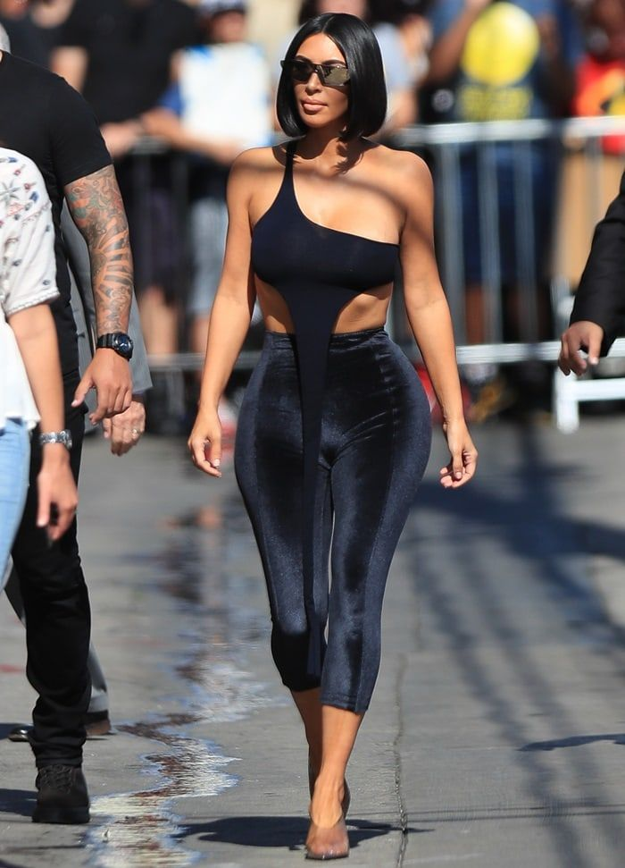 dd837b5ce358a Kim Kardashian styled the unique one-shoulder crop top with black velvet  Lisa Marie Fernandez leggings