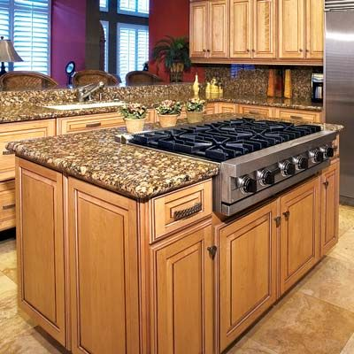 Cooktop: minimum of 12 inches on the sides and 9 inches behind the top. Vents, canopy or downdraft, must move at least 150 cfm for each linear foot of cooktop. Minimize duct bends to the outdoors.