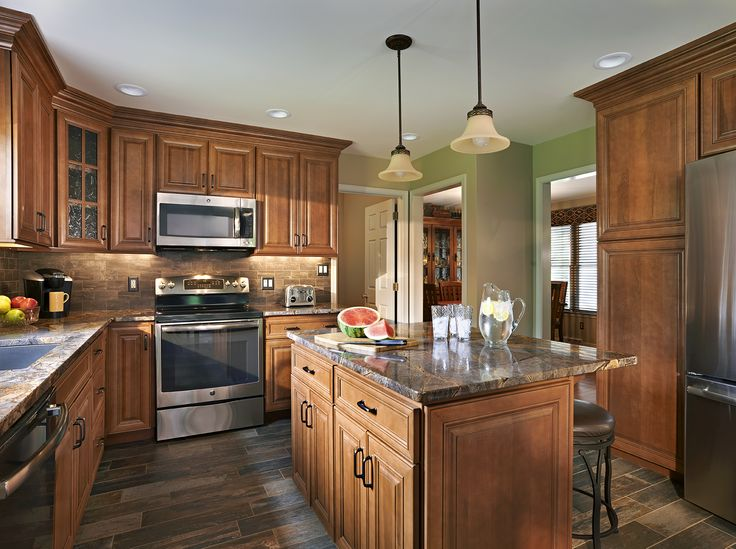 A warm cozy kitchen featuring WOLF Classic Cabinets in Hudson Heritage Brown  Wolf Classic