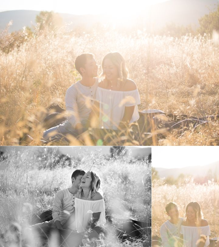 Cute couple sitting in tall grasses at sunrise