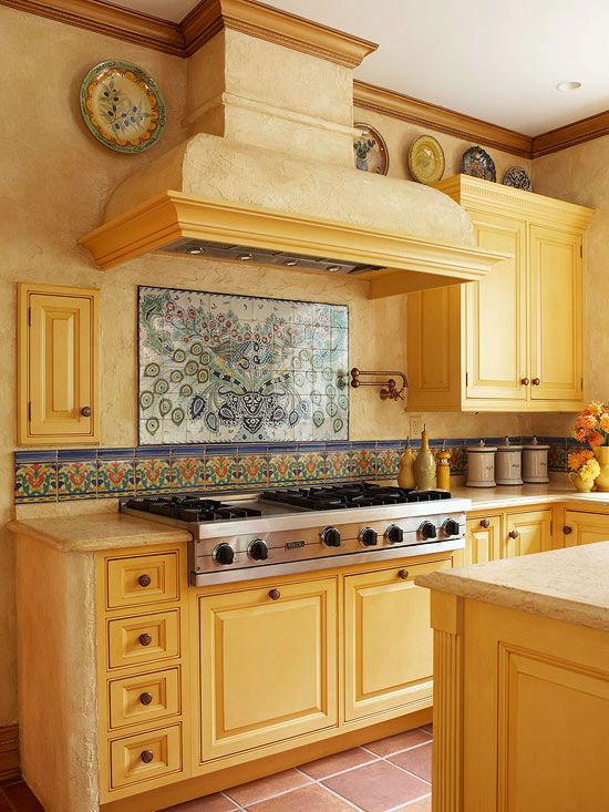 We love the hand-painted tiles in this kitchen! More kitchen backsplash photos: http://www.bhg.com/kitchen/backsplash/kitchen-backsplash-photos/?socsrc=bhgpin061213mexicotile=14