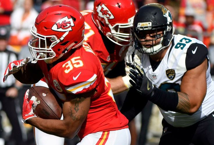 Jaguars vs. Chiefs  -  19-14, Chiefs  -  November 6, 2016  -   Kansas City Chiefs running back Charcandrick West (35) is pursued by Jacksonville Jaguars defensive end Tyson Alualu (93) during the first half of an NFL football game in Kansas City, Mo., Sunday, Nov. 6, 2016.