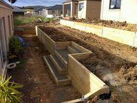 Timber Retaining Wall with Steps. Landscaper Pakenham - Ground Up Garden Renovators www.gardenrenovators.com.au