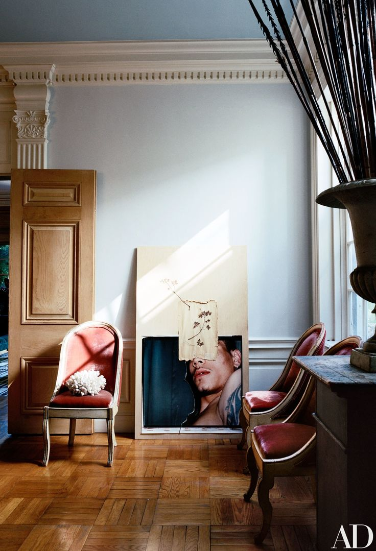 A collage by Matthias is propped in the corner of the dining room | archdigest.com