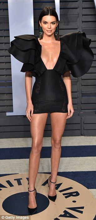 Battle of the babes: Kendall Jenner put on a busty display in a black mini dress as she jo...