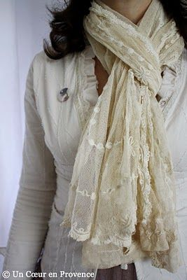 Old French ecru tulle embroidered with garlands of flowers in large satin stitch worn as a scarf.