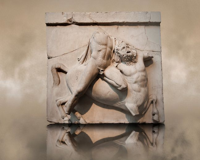 Sculpture of Lapiths and Centaurs battling from the Metope of the Parthenon on the Acropolis of Athens. South Metope no II. Also known as the Elgin marbles. British Museum London. The Lapith holds a Centaur by the throat. The diagnal of the Lapiths body across the Centaur is often used in Greek Classical art to depict strife.| © Paul Randall Williams 2012.