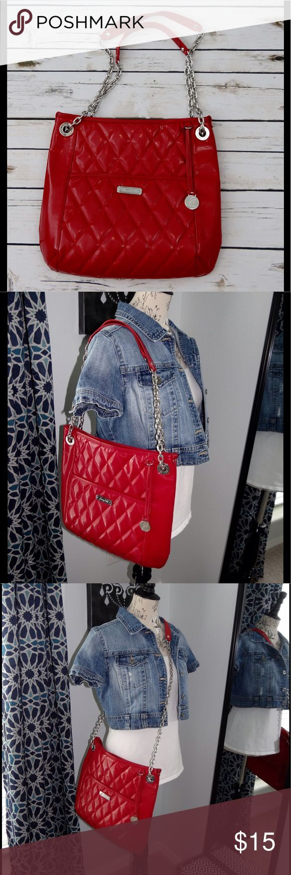 Grace Adele shoulder/cross body red bag Grace Adele shoulder/cross body red bag. Gently used, good, clean condition. Has a few small/minor scuffs that are hard to see. The bags straps are movable (NOT removable) to change from a shoulder bag to a cross body bag (great for when you are out shopping without a cart 🛒). Shinny red material. Similar to a patent leather. Chrome accents. 14 inches across and 13 inches deep. Smoke free and pet free home. Grace Adele Bags
