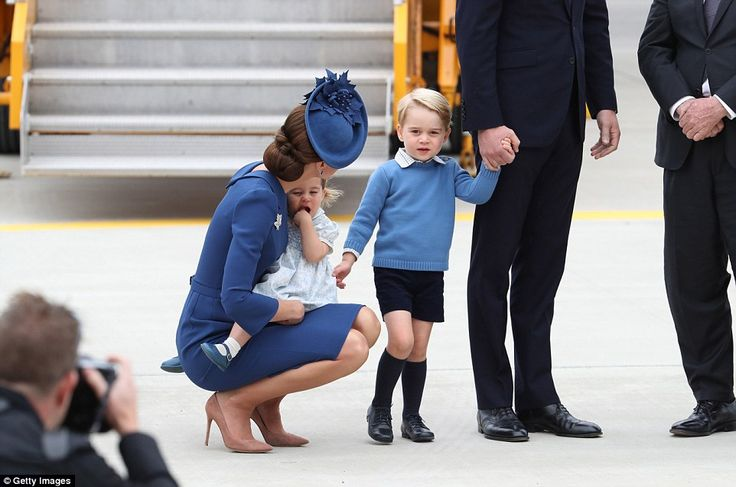 The Duchess of Cambridge spoke to her son - who was holding his father's hand - after the family landed in Victoria, Canada