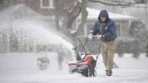 Charles H. Zimmerman of Johnstown, Pa., blows snow from the church driveway on Monday after a late winter storm dumped several centimetres on the region. Forecasters say similar weather is headed for Nova Scotia. (THE ASSOCIATED PRESS)