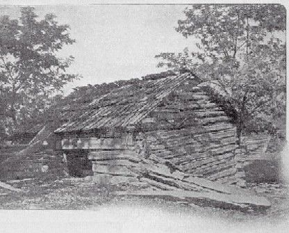 The cabin in which Daniel Boone lived, St. Charles county -- this is a scan of a photograph published in 1904: