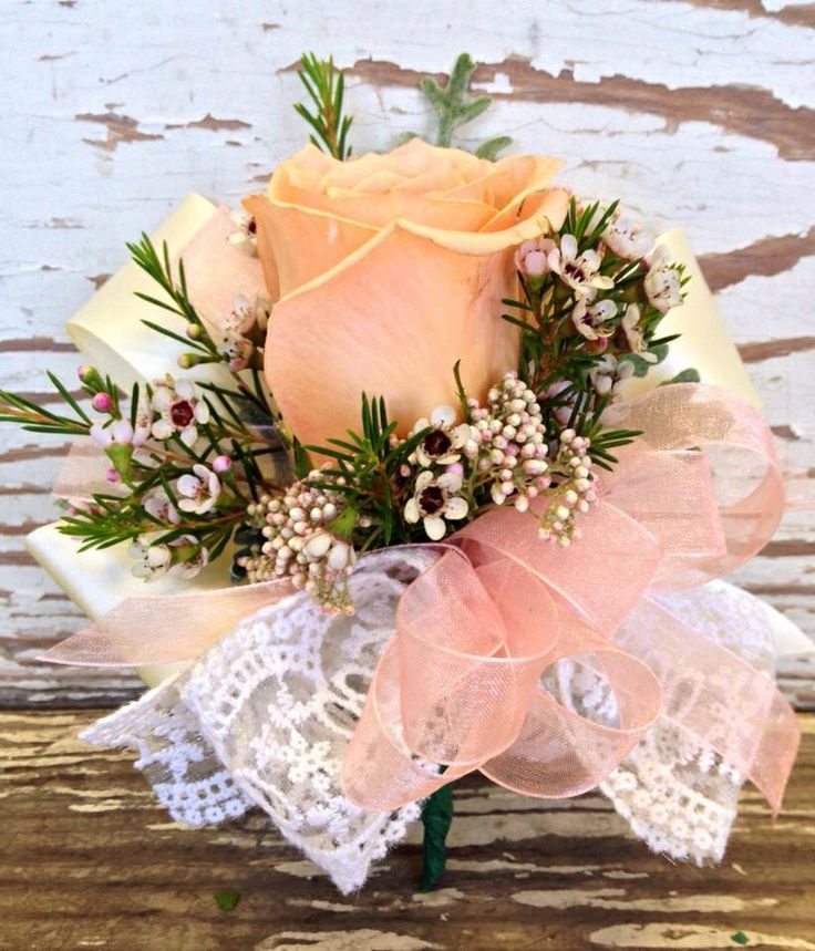 Mothers Corsage: rose with wax flower. Lace ribbon