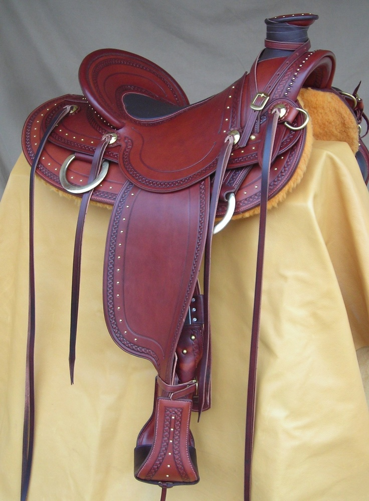 Made of the finest materials, this saddle would make any owner proud. Deep chestnut leather offsets the brass spots and hardware. Includes my deep centered. padded seat, spotwork, and matching stirrups. Many accessories are available - $3800-SR