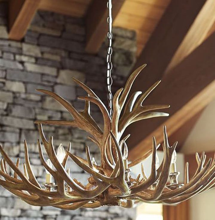 The French Bedroom Company Blog - Real Antler Chandeliers, Unique Lighting for your home. Tips and tricks for hanging our antler chandeliers in your home. From hunting lodge chic, modern scandi interior or ski chalet design, our stag antler lights are perfect.Loft apartment with exposed beams and stone walls
